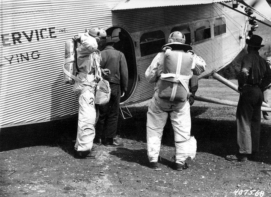 Two jumpers about to take off in Ford Trimotor plane, Lolo National Forest, Montana.