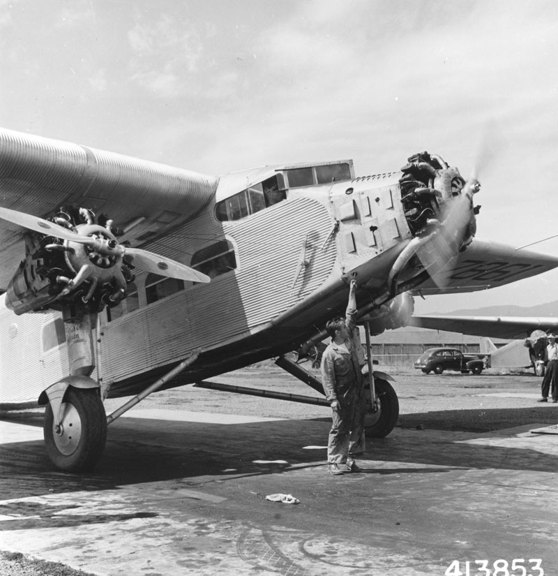 Ford Trimotor plane under contract from Johnson Flying Service about to take off with a squad of smokejumpers.