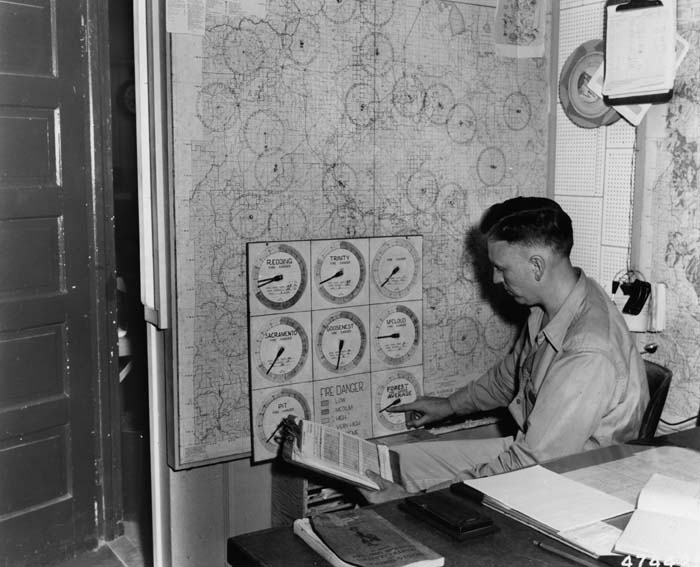 Arranging fire-danger chart for the districts on the Shasta National Forest, 1953.