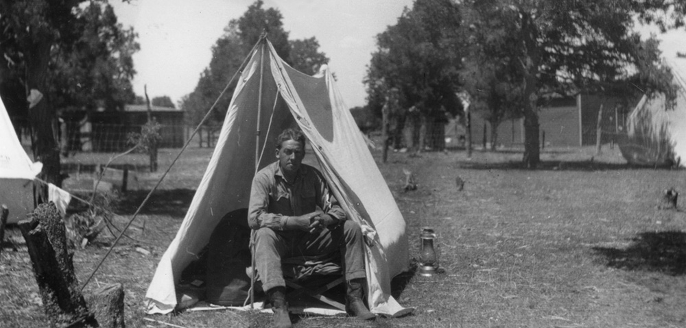 Raymond Marsh in tent, 1911.