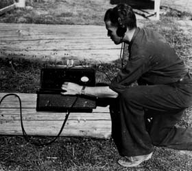 Chuck Wellner measures charges with the Blinkometer to determine log moisture content (U.S. Forest Service, Gisborne Collection).
