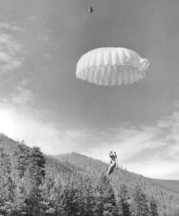 USFS smokejumper nearing the landing spot, Lolo National Forest, Montana, 1956.