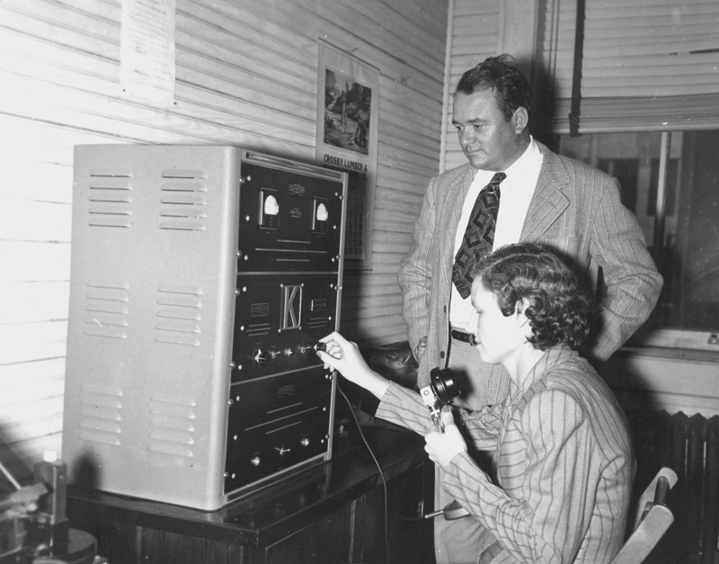 Radio dispatcher Lucile Hopkins demonstrates radio.