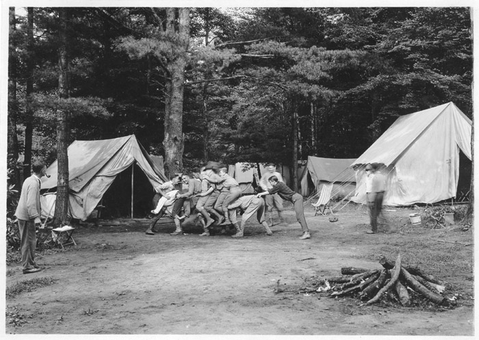 Caption [Group of Penn State forestry school students climbing on each other in c& ca. 1922. Several tents in background; firewood piled in foreground; ... & Education-Early Forestry Education-Penn State University - Forest ...