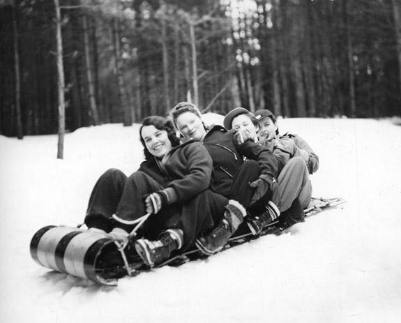 Group of girls enjoying a toboggan slide.