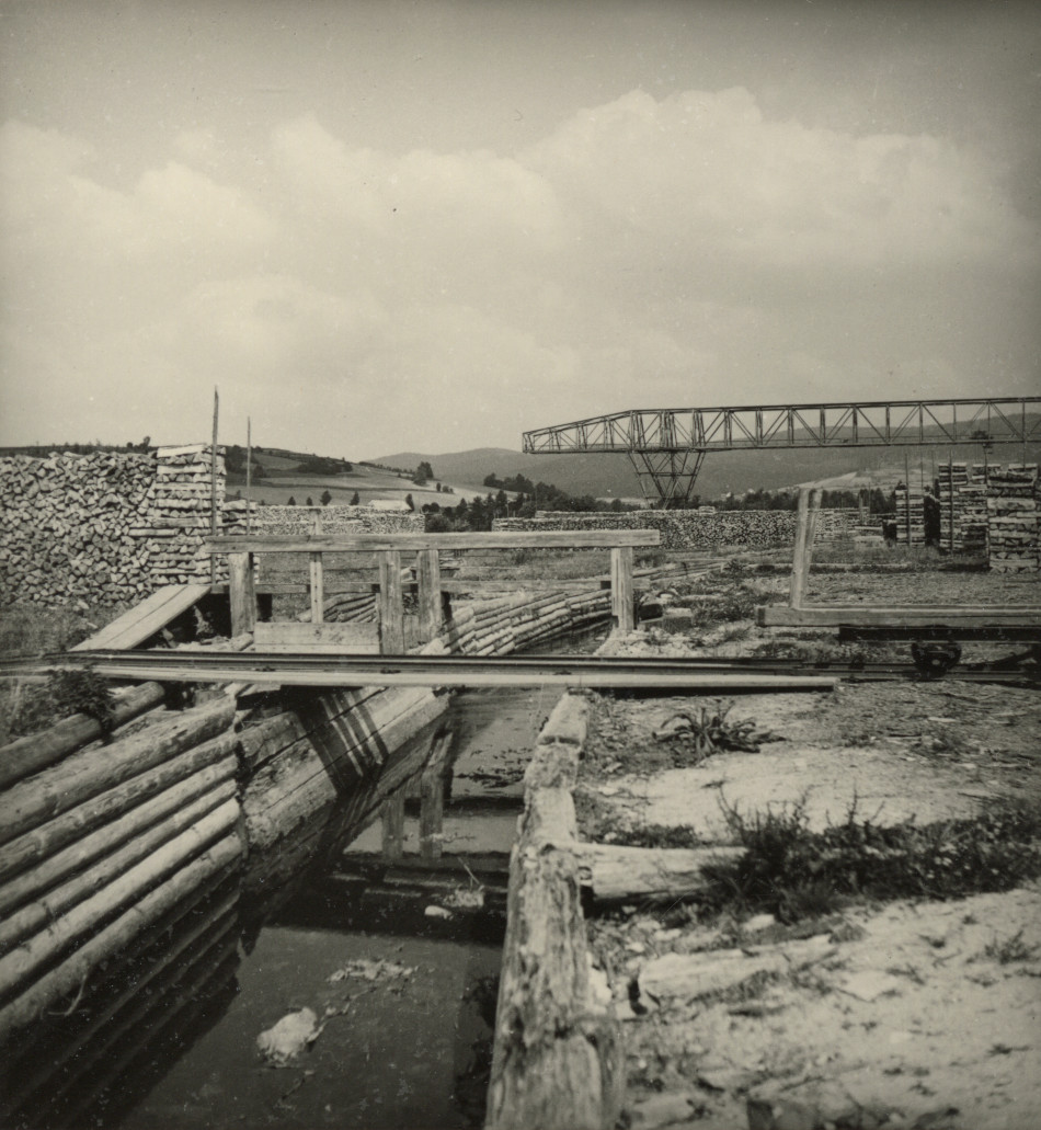 [Lumber yard and water channel.][Photo from the Clarence Forsling Papers. Photos document Forsling's 1935 trip to Europe funded by the Carl Schurz Memorial Foundation and the Oberlaender Trust.]