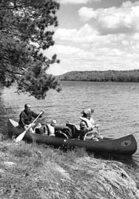 George Nyman family canoeing on Moose Lake, Superior National Forest, 1964.