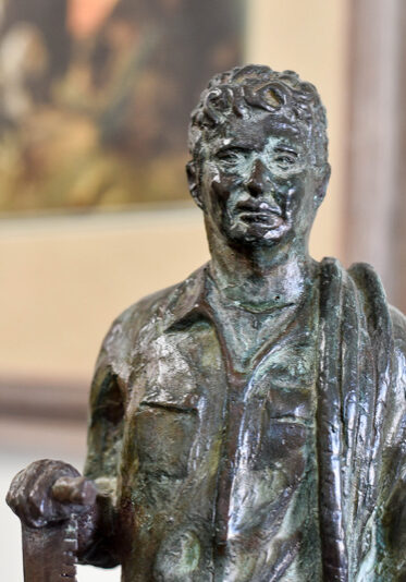 bronze statue of a young man